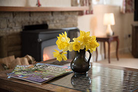 Log burning fire self catering holiday cottage
